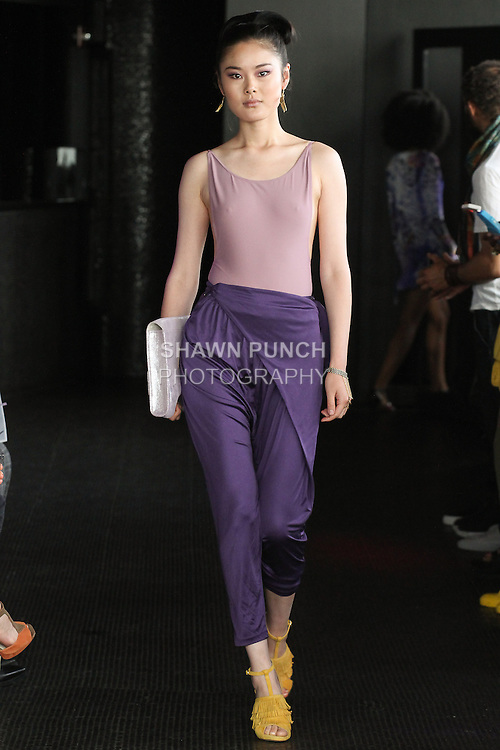 Chen walks runway in a silk jersey wrap pant and body suit from the Carlton Jones Resort 2017 collection fashion show at Le Bain in The Standard Hotel in New York City, on June 8, 2017.