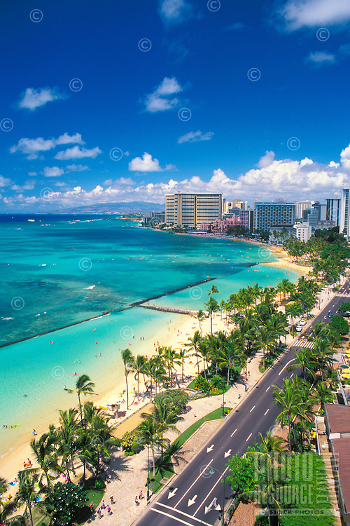 A  spectacular view of beautiful Waikiki Beach. Kalakaua Ave. in the forground. This shot taken from the  Hawaiian Regent Hotel.