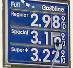 Gasoline sign with prices per gallon.