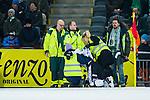 Stockholm 2014-01-10 Bandy Elitserien Hammarby IF - Sandvikens AIK :  <br />  Sandvikens Magnus Muhr&eacute;n har skadat sig under den andra halvleken och f&aring;r hj&auml;lp av sjukv&aring;rdare. H&auml;r rasar Sandvikens Magnus Muhr&eacute;n ihop efter att ha f&ouml;rs&ouml;kt g&aring; en bit vid planen<br /> (Foto: Kenta J&ouml;nsson) Nyckelord:  skada skadan ont sm&auml;rta injury pain