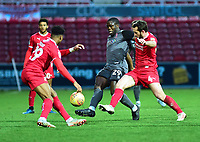 Lincoln City's John Akinde vies for possession with Swindon Town's Ali Koiki, left, and Jak McCourt<br /> <br /> Photographer Andrew Vaughan/CameraSport<br /> <br /> The EFL Sky Bet League Two - Swindon Town v Lincoln City - Saturday 12th January 2019 - County Ground - Swindon<br /> <br /> World Copyright &copy; 2019 CameraSport. All rights reserved. 43 Linden Ave. Countesthorpe. Leicester. England. LE8 5PG - Tel: +44 (0) 116 277 4147 - admin@camerasport.com - www.camerasport.com