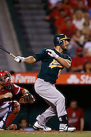 George Kottaras #14 of the Oakland Athletics bats against the Los Angeles Angels at Angel Stadium on September 10, 2012 in Anaheim, California. Oakland defeated Los Angeles 3-1. (Larry Goren/Four Seam Images)