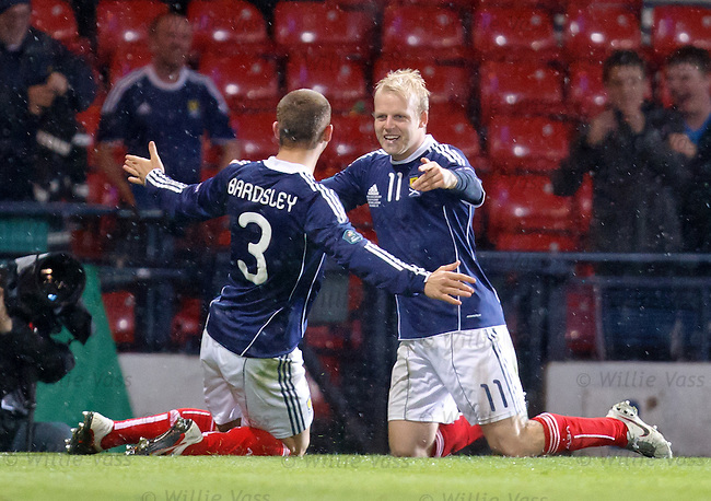 Steven Naismith celebrates his goal for Scotland with Phil Bardsley