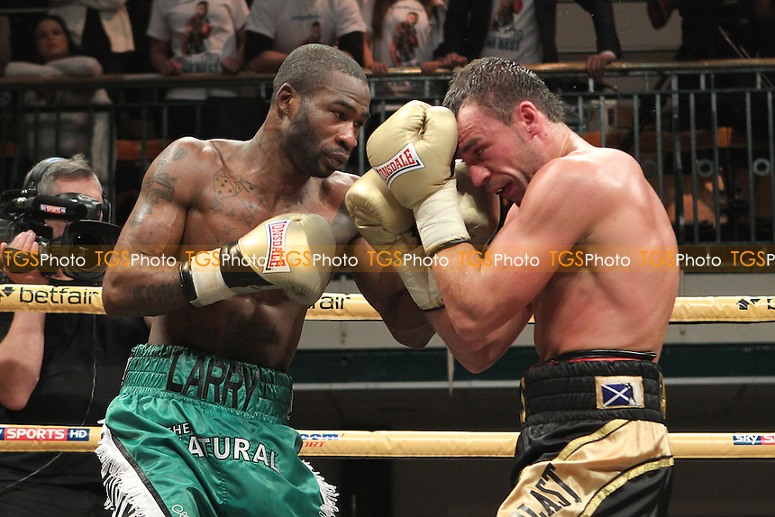 Larry Ekundayo (green shorts) defeats Kris Carslaw in a Prizefighter The Light-Middleweights III boxing contest at York Hall, Bethnal Green, London, promoted by Matchroom Sports - 03/11/12 - MANDATORY CREDIT: Gavin Ellis/TGSPHOTO - Self billing applies where appropriate - 0845 094 6026 - contact@tgsphoto.co.uk - NO UNPAID USE.