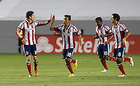 CARSON, CA - May 19, 2012: Chivas USA defender/midfielder Jorge Villafana (19) gets a high five from Chivas USA midfielder Martin Ponce (18) during the Chivas USA vs Real Salt Lake match at the Home Depot Center in Carson, California. Final score, Chivas USA 1, Real Salt Lake 4.