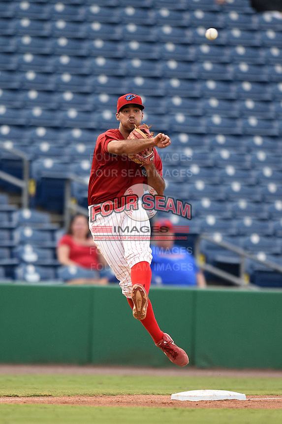 Clearwater Threshers third baseman Harold Martinez (11) throws to first during a game against the Tampa Yankees on June 26, 2014 at Bright House Field in Clearwater, Florida.  Clearwater defeated Tampa 4-3.  (Mike Janes/Four Seam Images)