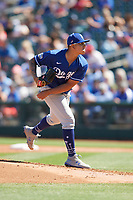 Los Angeles Dodgers starting pitcher Julio Urias (7) follows through on a pitch during a Cactus League Spring Training game against the Texas Rangers on March 8, 2020 at Surprise Stadium in Surprise, Arizona. Rangers defeated the Dodgers 9-8. (Tracy Proffitt/Four Seam Images)