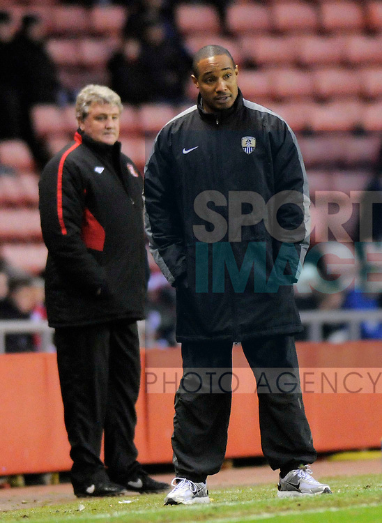 Sunderland's Steve Bruce and Notts County's Paul Ince.