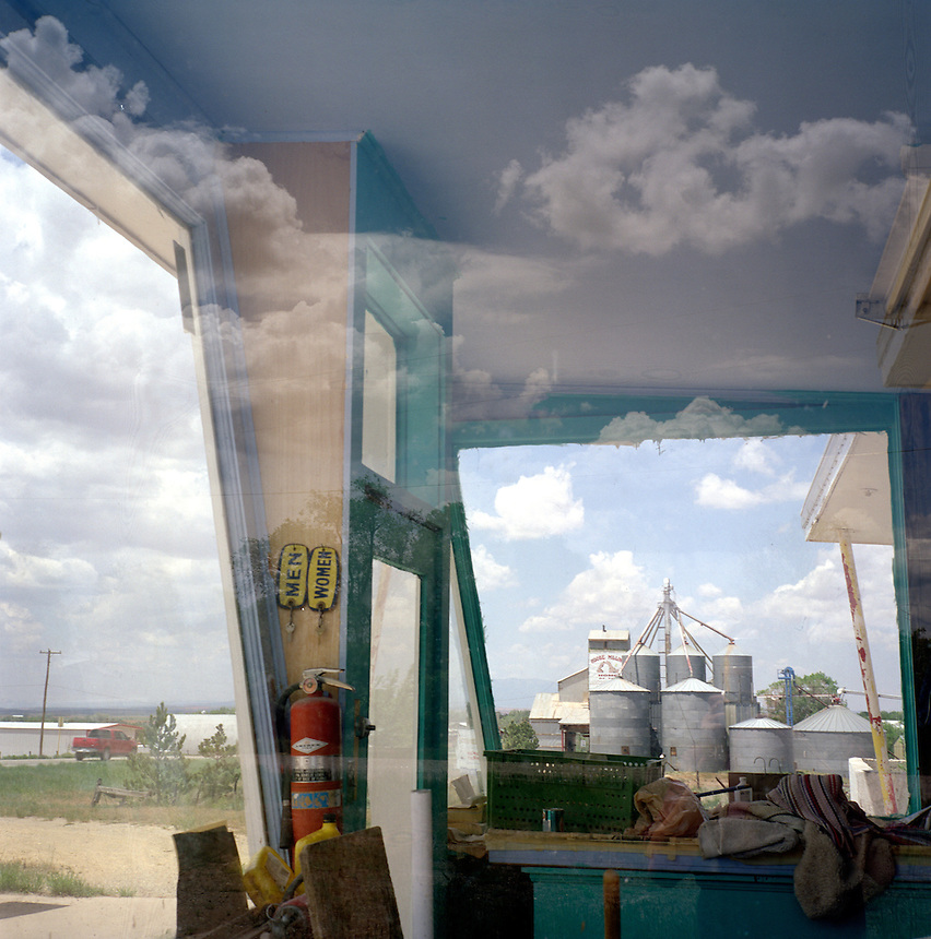 Clouds reflect in the windows of an abandoned gas station in Dove Creek, Colo., along U.S. Highway 666. Citizen groups petitioned the federal government to change the number of the road for fear the devilish connection contributed to accident and fatality rates on the highway.
