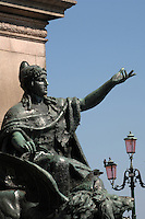 Statue of woman with hand held out on the canal promenade, Venice, Italy, May 2007.