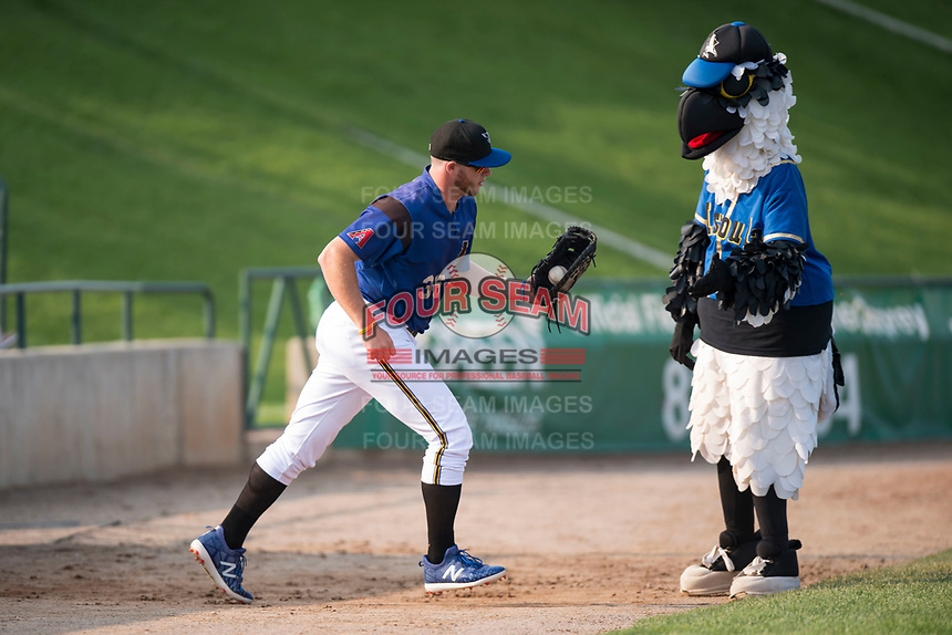 Missoula Osprey first baseman Zack Shannon (36) gets a high five from Ollie Osprey before a Pioneer League game against the Grand Junction Rockies at Ogren Park Allegiance Field on August 21, 2018 in Missoula, Montana. The Missoula Osprey defeated the Grand Junction Rockies by a score of 2-1. (Zachary Lucy/Four Seam Images)