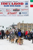 Kaci Murringer and team leave the ceremonial start line with an Iditarider and handler at 4th Avenue and D street in downtown Anchorage, Alaska on Saturday March 7th during the 2020 Iditarod race. Photo copyright by Cathy Hart Photography.com
