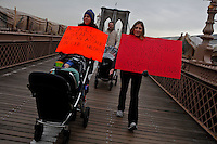 People take part during a march across the Brooklyn Bridge with One Million Moms for Gun Control, a gun control group formed in the wake of last month's massacre at a Newtown, Connecticut elementary school in New York, United States. 21/01/2013. Photo by Kena Betancur/VIEWpress.