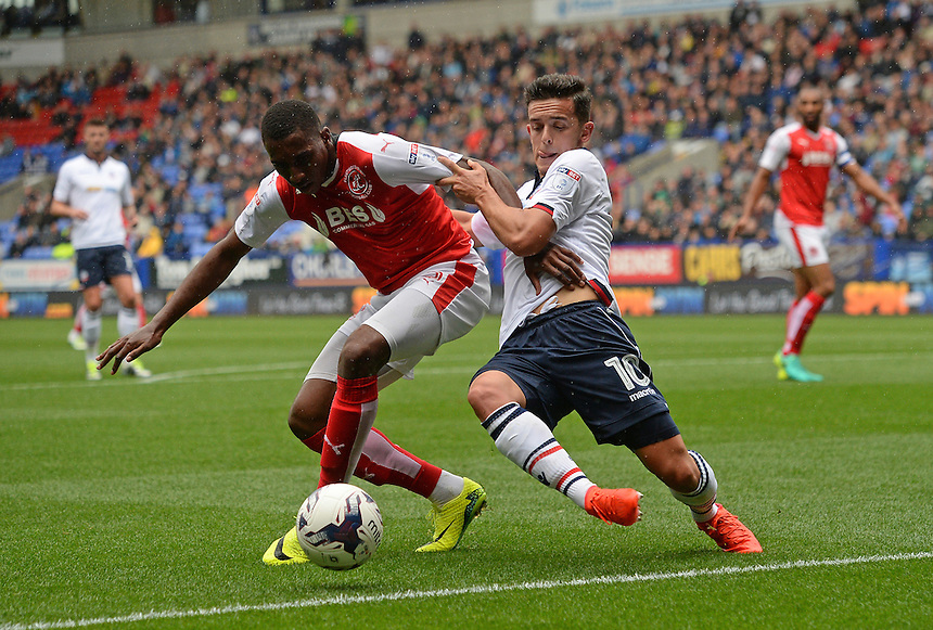 Bolton Wanderers's Zach Clough battles with Fleetwood Town's Amari'i Bell<br /> <br /> Photographer Ian Cook/CameraSport<br /> <br /> Football - The EFL Sky Bet League One - Bolton Wanderers v Fleetwood Town - Saturday 20 August 2016 - Macron Stadium - Bolton<br /> <br /> World Copyright &copy; 2016 CameraSport. All rights reserved. 43 Linden Ave. Countesthorpe. Leicester. England. LE8 5PG - Tel: +44 (0) 116 277 4147 - admin@camerasport.com - www.camerasport.com