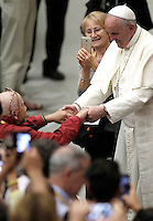 Papa Francesco saluta un bambino al termine di un'udienza alle Cellule Parrocchiali di Evangelizzazione, in Aula Paolo VI, Citta' del Vaticano, 5 settembre 2015.<br /> Pope Francis greets the faithful at the end of an audience to the Evangelization Parish Cells in the Paul VI hall at the Vatican, 5 September 2015.<br /> <br /> UPDATE IMAGES PRESS/Isabella Bonotto<br /> <br /> STRICTLY ONLY FOR EDITORIAL USE