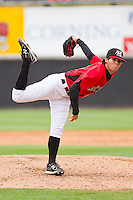 Relief pitcher Cody Buckel #22 of the Hickory Crawdads follows through on his delivery against the Greensboro Grasshoppers at L.P. Frans Stadium on May 18, 2011 in Hickory, North Carolina.   Photo by Brian Westerholt / Four Seam Images