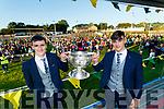 Keith O Leary and Captain Paul O Shea lift the Tom Markham cup at the Kerry Minor Football team homecoming at Kilcummin at Kilcummin GAA club on Monday night.
