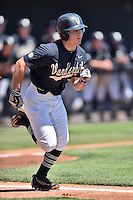 Vanderbilt Commodores left fielder Walker Grisanti (17) runs to first during a game agains against the Tennessee Volunteers at Lindsey Nelson Stadium on April 24, 2016 in Knoxville, Tennessee. The Volunteers defeated the Commodores 5-3. (Tony Farlow/Four Seam Images)