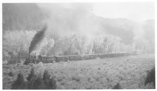 K-27 #455 with #452 tender working freight with helper at rear going from Placerville to Dallas Divide.<br /> RGS  between Placerville and Dallas Divide, CO  Taken by Radcliffe, William H. - 10/8/1950