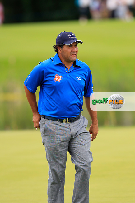 Ricardo Gonzalez (ARG) sinks his putt on the 8th green during Sunday's Final Round of the 2014 Irish Open held at Fota Island Resort, Cork, Ireland. 22nd June 2014.<br /> Picture: Eoin Clarke www.golffile.ie