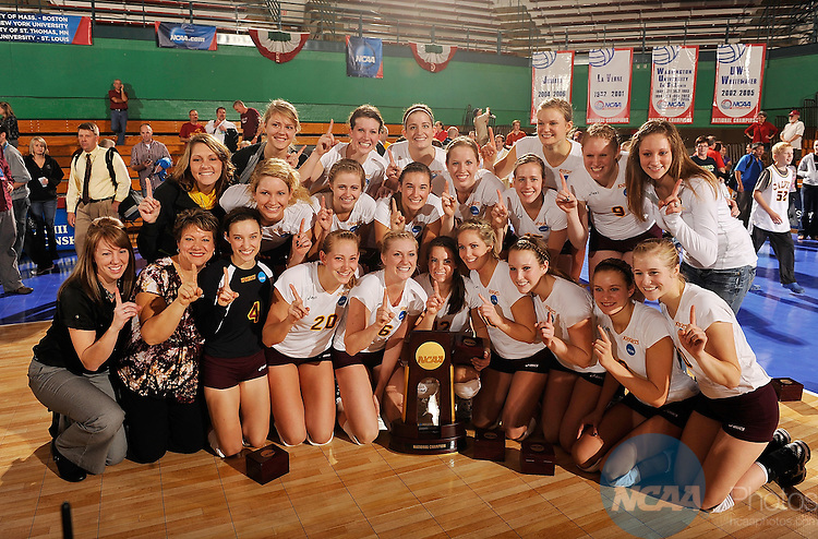 22 NOV 2010:  Calvin College teammates and coaches pose for a photo after defeating Emory University during the Division III Women's Volleyball Championship held at the Washington University Fieldhouse on the University of Washington- St. Louis campus in St. Louis, MO.  Calvin defeated Emory 3-1 for the national title.  Scott Rovak/ NCAA Photos