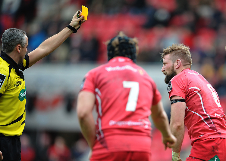 Referee John Lacey shows the yellow card to Scarlets' John Barclay<br /> <br /> Photographer Ian Cook/CameraSport<br /> <br /> Rugby Union - Guinness PRO12 - Scarlets v Edinburgh - Saturday 28th March 2015 - Parc y Scarlets - Llanelli<br /> <br /> &copy; CameraSport - 43 Linden Ave. Countesthorpe. Leicester. England. LE8 5PG - Tel: +44 (0) 116 277 4147 - admin@camerasport.com - www.camerasport.com