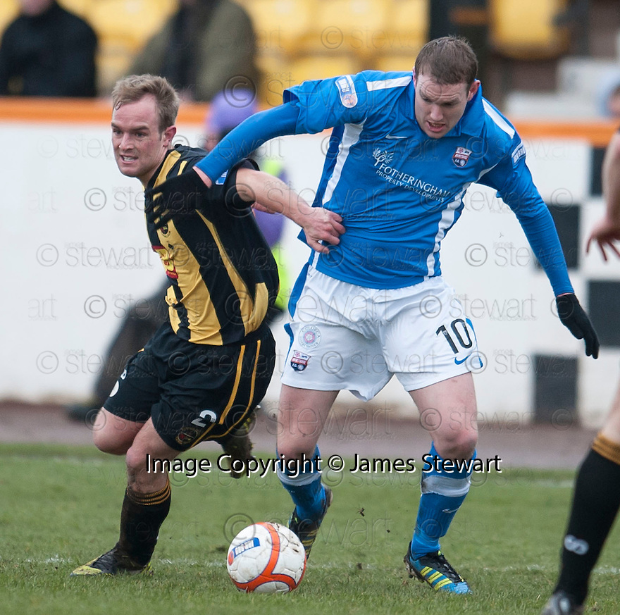 Montrose's Garry Wood tries to get away from Berwick's Devon Jacobs.