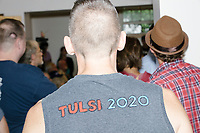 """James Sowles, of Boston, Mass., wears a home-made shirt reading """"Tulsi 2020"""" as Democratic presidential candidate and Hawaii representative (D-HI 2nd) Tulsi Gabbard speaks at a campaign event at Weare Public Library in Weare, New Hampshire, on Thu., September 5, 2019."""