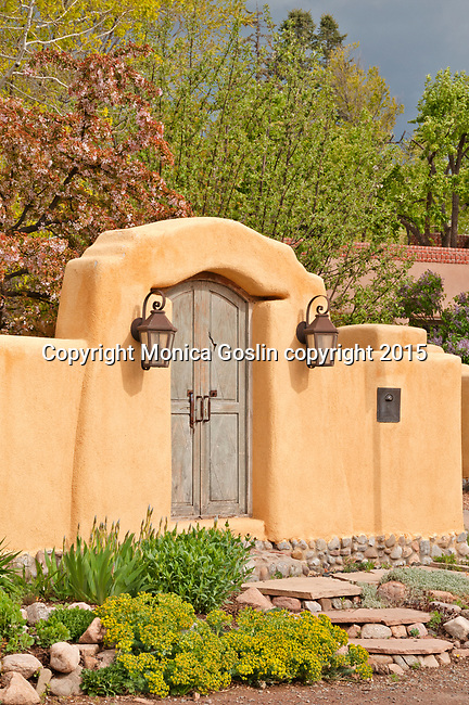 Houses in downtown Santa Fe, New Mexico that show the traditional architecture of adobe buildings in the area
