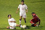22 January 2006: US defender Heath Pierce (left) plays the ball away from a Canadian player as teammate Kerry Zavagnin (5) looks on. The United States Men's National Team tied Canada 0-0 at Torero Stadium in San Diego, California in an International Friendly soccer match.