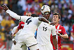 13 JUN 2010: John Pantsil (GHA) (4) heads the ball off of teammate Isaac Vorsah (GHA) (15)  as Aleksandar Lukovic (SRB) (13) watches. The Serbia National Team lost 0-1 to the Ghana National Team at Loftus Versfeld Stadium in Tshwane/Pretoria, South Africa in a 2010 FIFA World Cup Group D match.