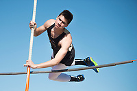 NWA Democrat-Gazette/CHARLIE KAIJO Brock McRae, 15, of Bentonville High pole vaults during the Tiger Relays track meet, Friday, March 16, 2018 at the Tiger Athletic Complex in Bentonville.