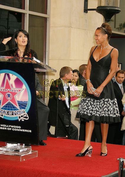 SALMA HAYEK & VANESSA L. WILLIAMS.Vanessa L. Williams Celebrates Her Birthday With a Star On The Hollywood Walk of Fame, Holllywood, California, USA..March 19th, 2007 .full length black floral print dress podium speech hand clear heels shoes .CAP/ADM/RE.©Russ Elliot/AdMedia/Capital Pictures
