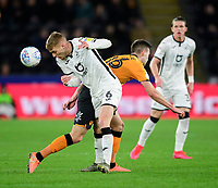 Swansea City's Jay Fulton vies for possession with Hull City's Robbie McKenzie<br /> <br /> Photographer Chris Vaughan/CameraSport<br /> <br /> The EFL Sky Bet Championship - Hull City v Swansea City -  Friday 14th February 2020 - KCOM Stadium - Hull<br /> <br /> World Copyright © 2020 CameraSport. All rights reserved. 43 Linden Ave. Countesthorpe. Leicester. England. LE8 5PG - Tel: +44 (0) 116 277 4147 - admin@camerasport.com - www.camerasport.com
