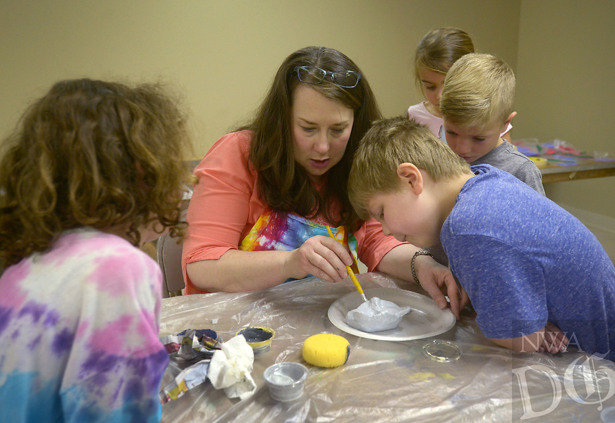 NWA Democrat-Gazette/BEN GOFF @NWABENGOFF<br /> Deborah Robbins instructs students in making clay gargoyles Friday, July 14, 2017, during ArtCamp: Medieval Adventure at First Presbyterian Church in Rogers. During the five-day camp for rising 1st through 7th graders, students made various art projects inspired by such things as illuminated manuscripts, stained glass windows, relief carving, tapestries and architecture.