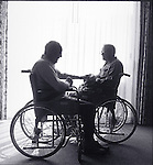 silhouette of elder men in wheelchairs