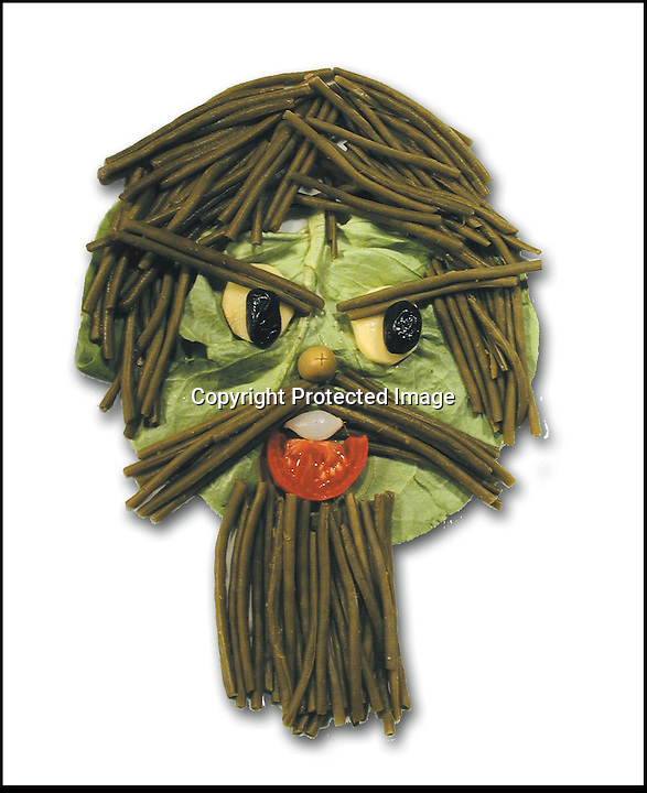 """BNPS.co.uk (01202 558833).Pic: DanielRicon/BNPS..***Please Use Full Byline***..Portrait of the artist...Leonardo Da Veggie!..An artist has transformed humble salad ingredients into works of art in a bid to encourage children to eat their greens...Daniel Ricon bought bags of lettuce, tomatoes, carrot, and cucumber and began layering them on a plate to make the healthy snacks seem more exciting...He created impressive pictures of animals including a cucumber crocodile, and a runner bean lion...Daniel also made a cat, duck, crab, owl, lion, rabbit, penguin, fish, cock, and even a martian...After completing each plate he took a picture and posted it to his website to document his wacky artwork...Daniel, 60, a visual artist from Paris in France, said: """"I have used flowers, leaves, stones, shells, hands, sweets and cakes in my work and it resulted in me working with vegetables...""""Working with vegetables is to present a fun way to eat food to children and invite them to try unusual things...""""The goal is to make a dish salad to encourage children to eat everything, the subjects are placed on a plate to be eaten......"""
