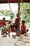 PHILIPPINES, Palawan, Barangay region, a Batak family sits in front of their home in Kalakwasan Village