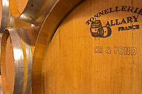 """Oak barrels marked with the cooper's name (Tonnellerie Allary) and """"CM & Fond"""". CM means Chauffe Moyenne (medium toasting of the interior of the barrique) and """"Fond"""" signifies the the flat end piece has also been toasted (le fond) which is unusual.  Chateau de Pressac St Etienne de Lisse  Saint Emilion  Bordeaux Gironde Aquitaine France"""