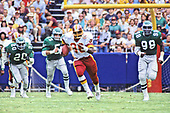 Washington Redskins running back George Rogers (38) breaks clear during the game against the Philadelphia Eagles at RFK Stadium in Washington, DC  on September 7, 1986.  Eagles in pursuit are strong safery Andre Waters (20), middle linebacker Mike Reichenbach (55), and right defensive end Greg Brown (98).  The Redskins won the game 41 - 14.<br /> Credit: Arnie Sachs / CNP