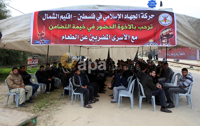 Palestinians gather in a sit-in tent near the Eriz crossing during a protest in solidarity with hunger-striking Palestinian prisoners held by Israel, demanding their releas northen Gaza strip on Feb. 05, 2013. Photo by Majdi Fathi