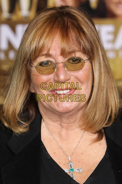 "PENNY MARSHALL.The World Premiere of ""New Year's Eve' held at The Grauman's Chinese Theatre in Hollywood, California, USA..December 5th, 2011.headshot portrait black tinted glasses.CAP/CEL .©CelPh/Capital Pictures."