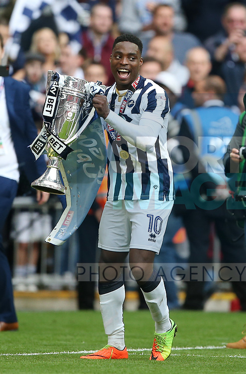 Millwall's Fred Onyedinma celebrates with the trophy during the League One Play-Off Final match at Wembley Stadium, London. Picture date: May 20th, 2017. Pic credit should read: David Klein/Sportimage