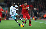 Roberto Firmino of Liverpool and Edmilson Fernandes of West Ham during the Premier League match at Anfield Stadium, Liverpool. Picture date: December 11th, 2016.Photo credit should read: Lynne Cameron/Sportimage