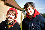Model released head and shoulders portrait of boy and girl twins standing together in winter, Suffolk, England