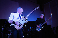17 DEC 2014 - STOWMARKET, GBR - Dr. Feelgood's Steve Walwyn (left) on lead guitar and Phill Mitchell on bass guitar performing at the John Peel Centre for Creative Arts in Stowmarket, Suffolk, Great Britain (PHOTO COPYRIGHT © 2014 NIGEL FARROW, ALL RIGHTS RESERVED)
