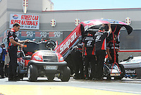 Apr. 1, 2012; Las Vegas, NV, USA: NHRA crew members for funny car driver Cruz Pedregon during the Summitracing.com Nationals at The Strip in Las Vegas. Mandatory Credit: Mark J. Rebilas-