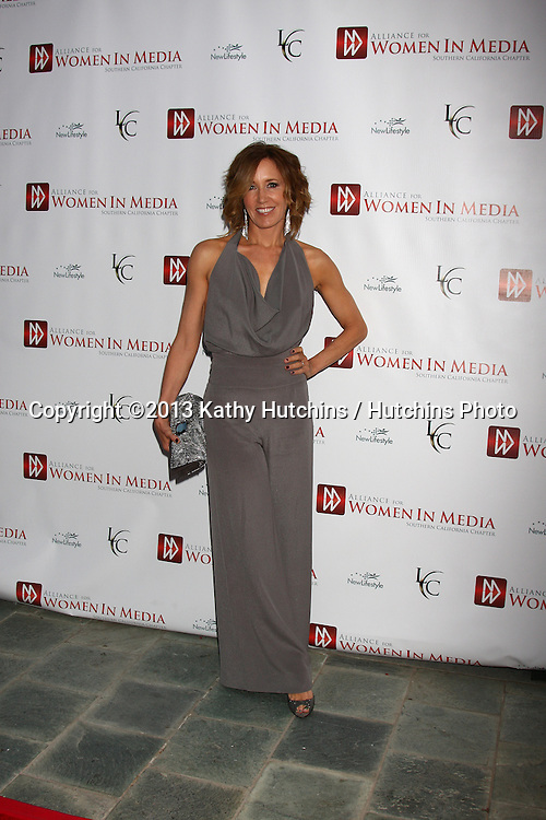 LOS ANGELES - APR 23:  Felicity Huffman arrives at the 2013 Genii Awards presented by the Aliance for Women in Media at the Skirball Cultural Center on April 23, 2013 in Los Angeles, CA