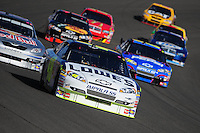 Aug 31, 2008; Fontana, CA, USA; NASCAR Sprint Cup Series driver Jimmie Johnson (48) leads the field during the Pepsi 500 at Auto Club Speedway. Mandatory Credit: Mark J. Rebilas-