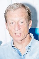 Democratic presidential candidate Tom Steyer speaks to the media after speaking at the Political Soapbox at the Iowa State Fair in Des, Moines, Iowa, on Sun., Aug. 11, 2019.